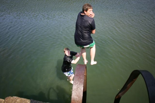 Two Kids Taking The Plunge